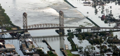 IMAGE: FLOODWATERS BREAK THROUGH LEVEE