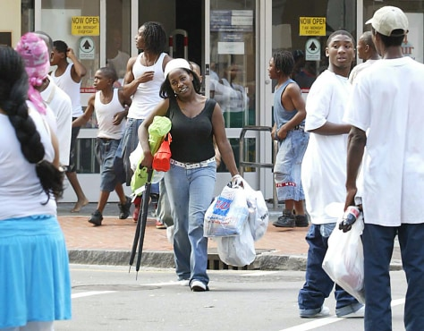 Image: Looters take whatever they can carry from a drug store in the French Quarter district of New Orleans on Tuesday.