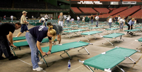 Image: Cots in Houston's Astrodome.