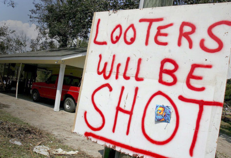Image: Warning sign against looters