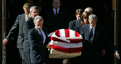 The casket of Supreme Court Chief Justice Rehnquist is carried from the cathedral in Washington