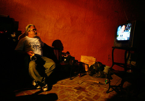 Images: Flood victim watches President Bush's speech.