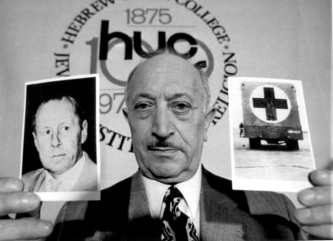 Image: Simon Wiesenthal holds photos, which he said were of Nazi criminal Walter Rauff, in May 1973.