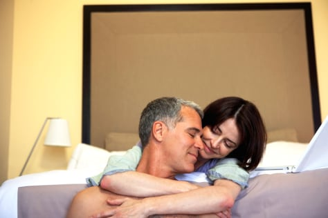 Couple Cuddling in Bedroom
