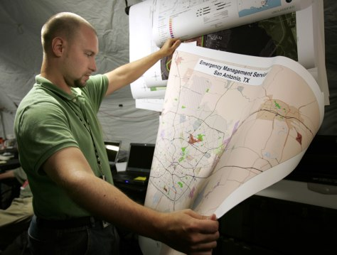 National Geospatial-Intelligence Agency analyst looks at a map