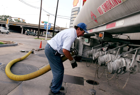 Image: Joe Salazar makes his last stop of the day as he delivers gas in Houston on Sunday.