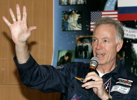 US space tourist Gregory Olsen gestures