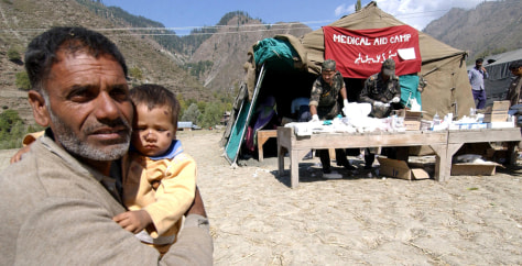 IMAGE: FATHER, SON IN REFUGEE CAMP