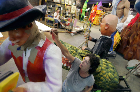 Carter fixes floats damaged by Hurricane Katrina at Mardi Gras World in Algiers