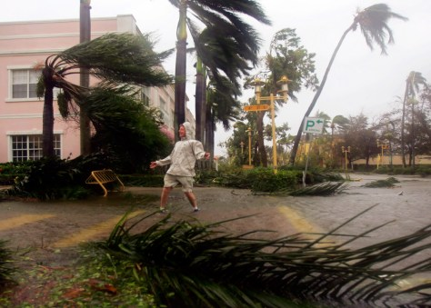 A man plays in the winds on Fifth Avenue in downtown Naples of Florida