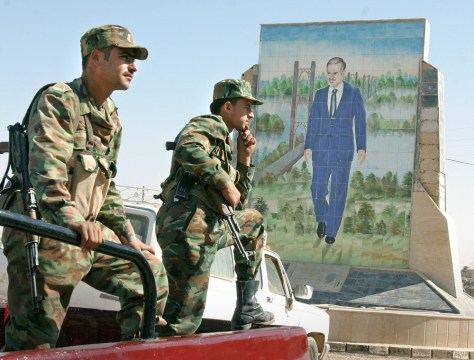 Syrian border officials stand guard at the Syrian-Iraqi border at Abu Kamal