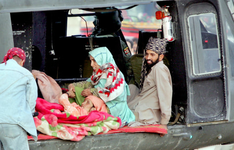 Injured earthquake survivors lie in a helicopter as they leave for Islamabad in Balakot