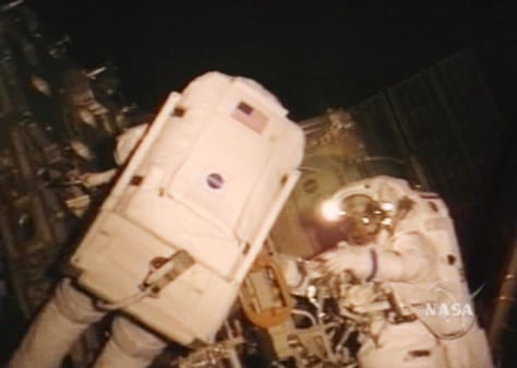 Tokarev and McArthur work outside space station