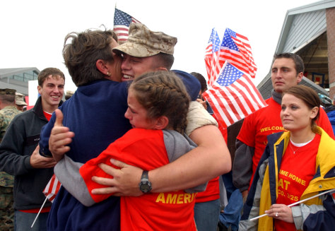Lance Cpl. Ryan of the Company L, 3rd Battalion, 25th Marine Regiment celebrates with family in Columbus