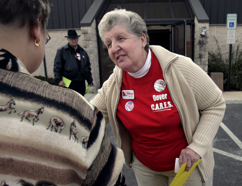 "supporter of Dover ""C.A.R.E.S."" slate approaches voter"
