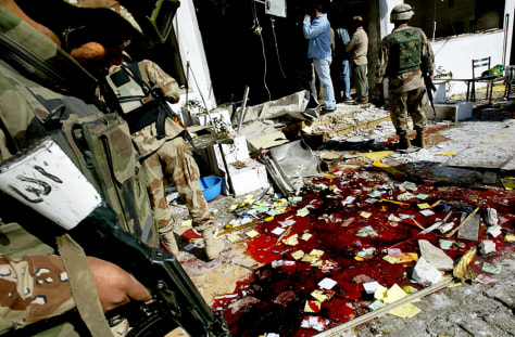 Image: Blood outside bombed Baghdad restaurant
