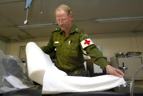 Image: Danish officer holds a singing pillow