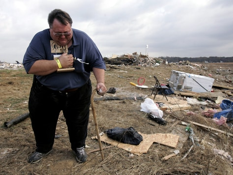 IMAGE: TORNADO SURVIVOR AT MOBILE HOME PARK