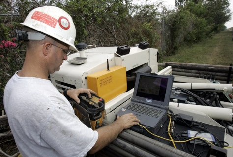 Image: Engineer examines New Orleans levee