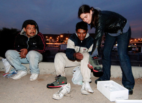 IMAGE: ARTIST HANDS OUT SPECIAL SHOES