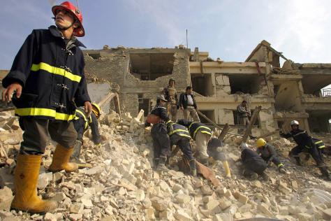 Members of Iraqi civil defense look for