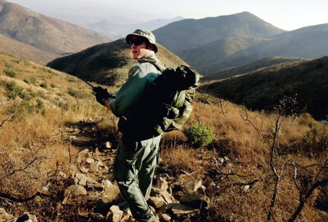 Image: Border Patrol agent Jeff Mielke follows a trail in the Otay Mesa Mountain Range near Dulzura, Calif., in October. Mielke is part of an elite patrol unit that combs remote parts of the border that are inaccessible to vehicles.