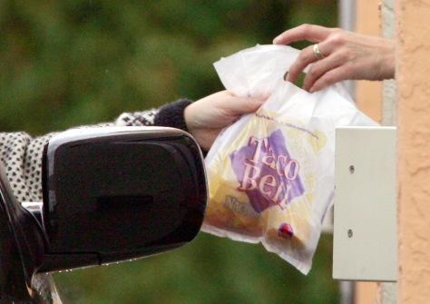 Image: Taco bell employee handing over food