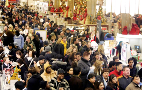 Holiday shoppers make their way through Macy's in New York