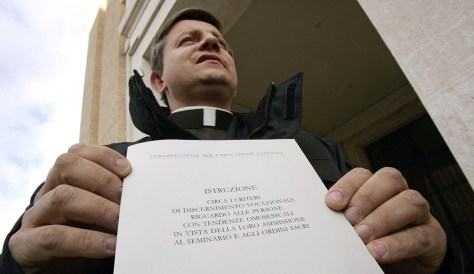 Image: Polish priest P. Jarek Cielecki shows off the official Vatican document released Tuesday, which restricts homosexuals from entering the Catholic priesthood.