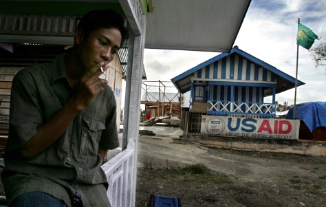 MAN SMOKES BY USAID HEADQUARTERS