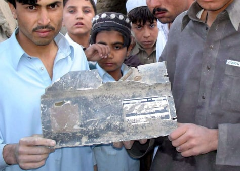 Image: Tribesmen display piece of U.S.-made missile.