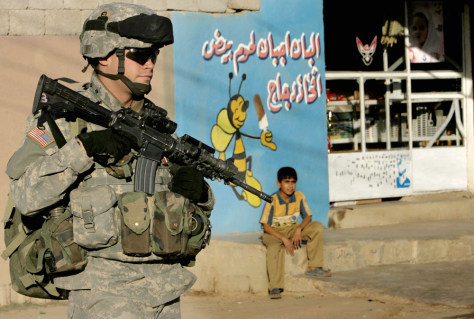 Image: A U.S. soldier secures a neighborhood in Kirkuk.