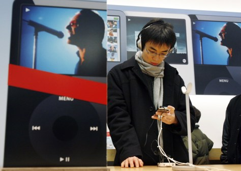Chunyiu Fu tries an iPod at the Apple Store on Chicago's Magnificent Mile