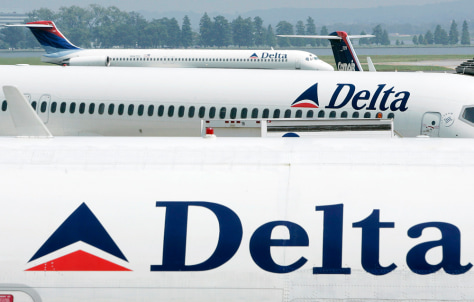 File photo of Delta Airlines jets seen at a terminal at Reagan National Airport outside Washington