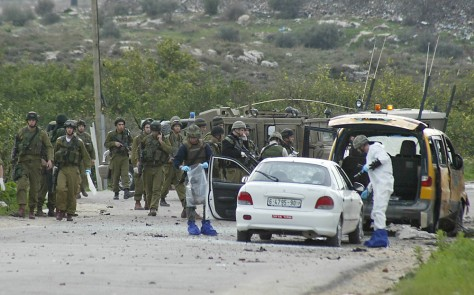 Image: Israeli soldiers at site of explosion.