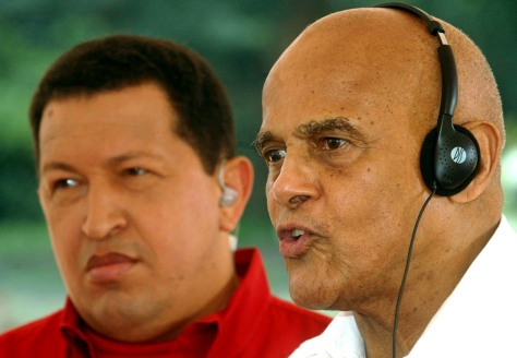 American singer Belafonte speaks as Venezuela's President Chavez looks on during Chavez's weekly broadcast in El Consejo