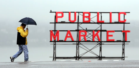 IMAGE: MAN WITH UMBRELLA IN SEATTLE RAIN