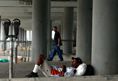 A homeless man sleeps under an overpass in Houston