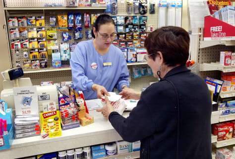 Image: Pharmacy worker and customer