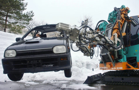 Rescue robot lifts car from snow