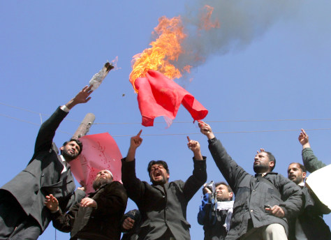 Afghan protesters burn a Danish flag in Kabul, on Wednesday.