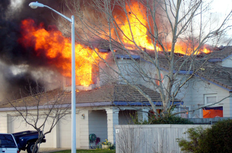 Image: House hit by plane seen on fire.