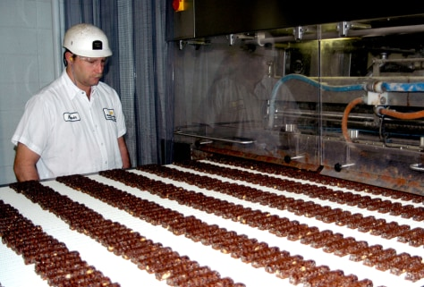 Kevin Tilley scrutinizes CocoaVia chocolate bars moving down a production line at Mars Inc.'s plant in Albany, Ga., on Feb. 1.