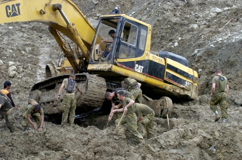 US Marines dig out a backhoe that got st