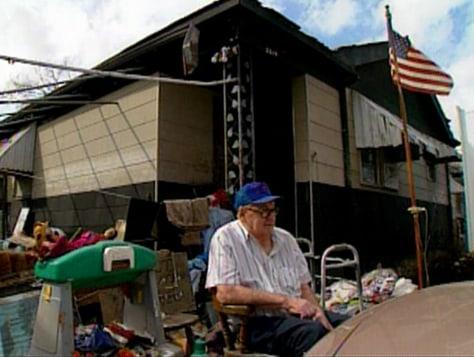 Lawrence Kampa, 84, outside his uninhabitable New Orleans home.