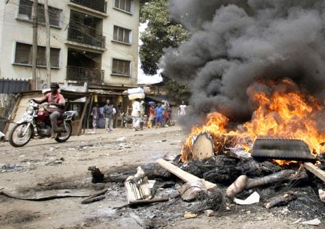 Bodies and debris burn in Onitsha, Nigeria