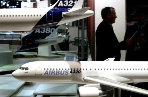 SILHOUETTE OF MAN STANDING BEHIND AIRBUS A320