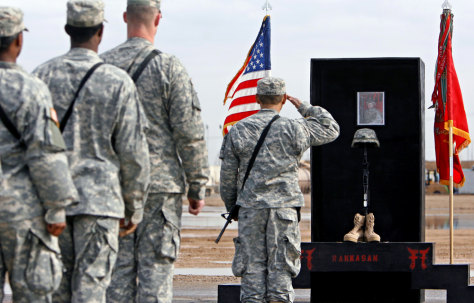 US Army soldier salutes at memorial service for slain comrade at Camp Remagen near Iraqi city of Tikrit