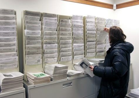 A taxpayer picks up forms