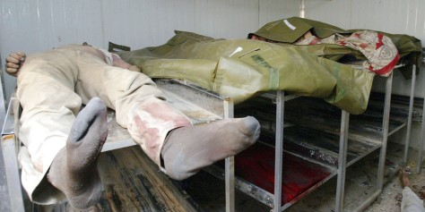 Bodies of Iraqi men found hanged or shot in an abandoned minibus in Baghdad Wednesday lie in a hospital morgue.